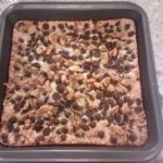 Pan of Magic Bars, sweet and chewy bars covered with coconut and chocolate chips