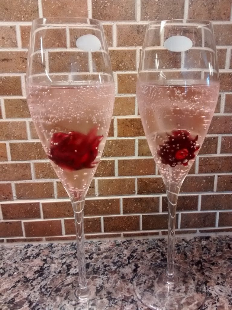 champagne flutes with hibiscus flowers