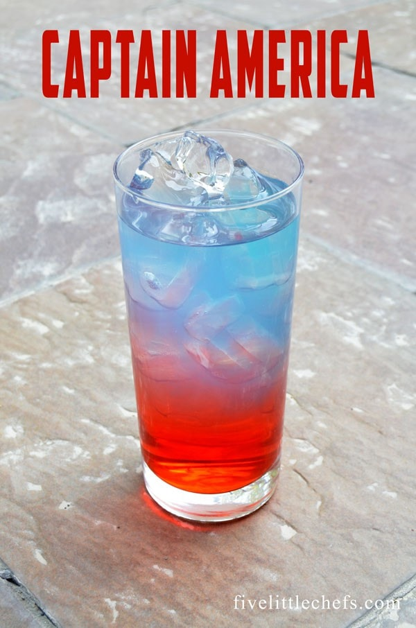 Colorful non-alcoholic drink, red and blue, in tall glass filled with ice