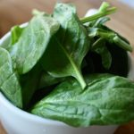 Baby spinach in white ceramic bowl