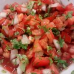 Fresh salsa with tomatoes, onion and cilantro in a bowl