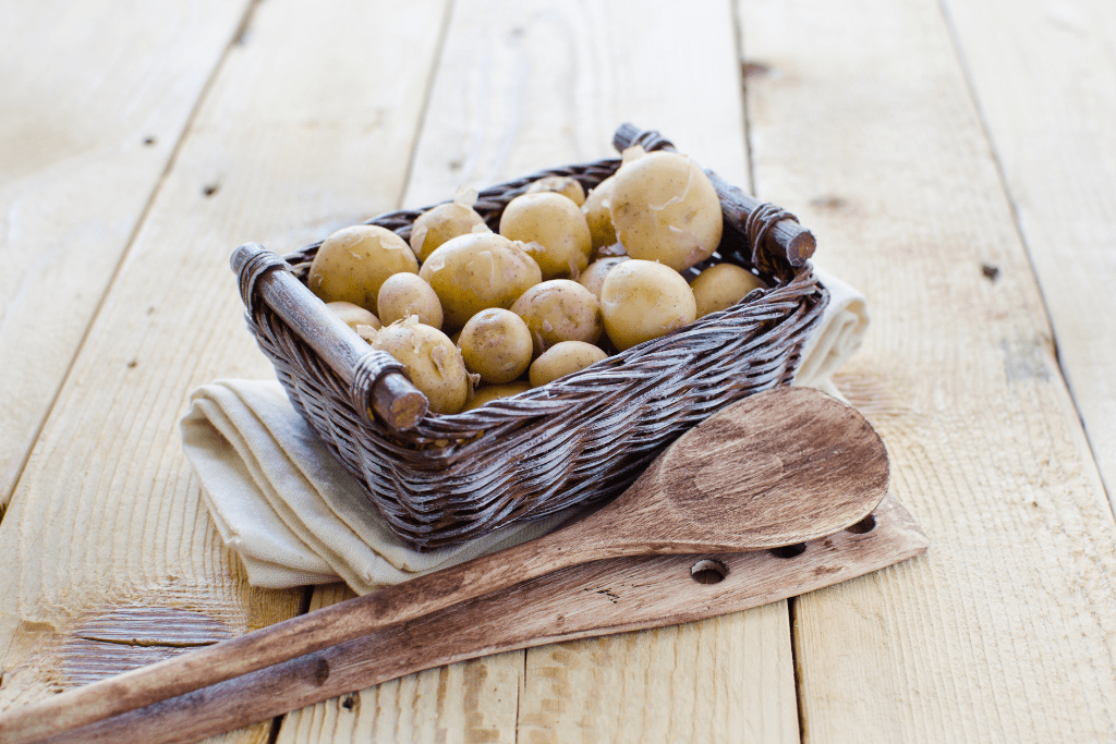 Small basket with new potatoes.