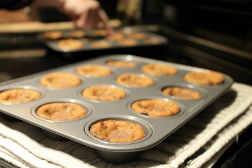 Freshly baked cookie cups in mini muffin tin