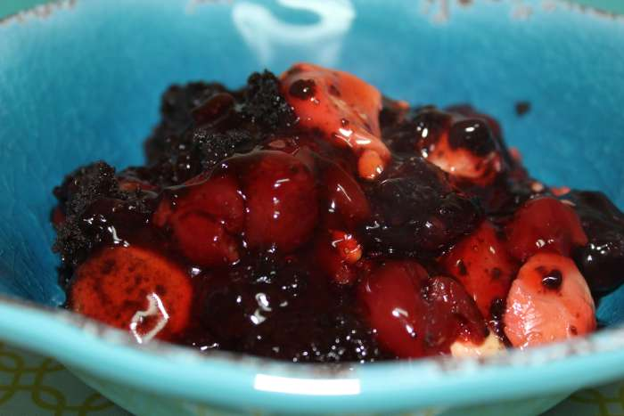 Blue bowl with delicious cherry cobbler