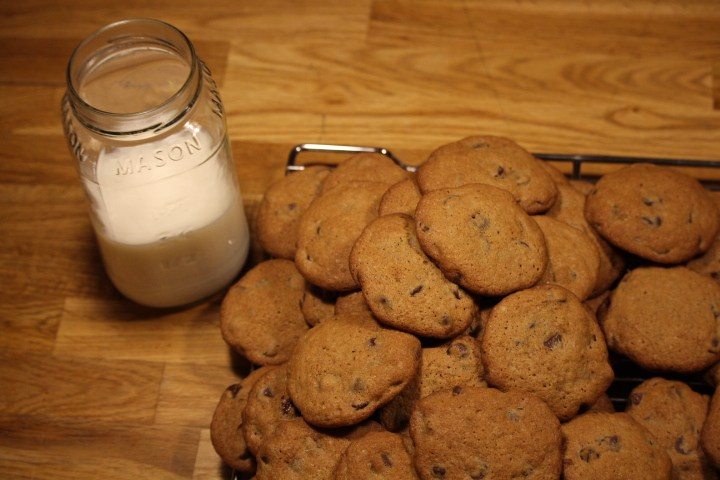 Plate of fresh cookies with glass of milk