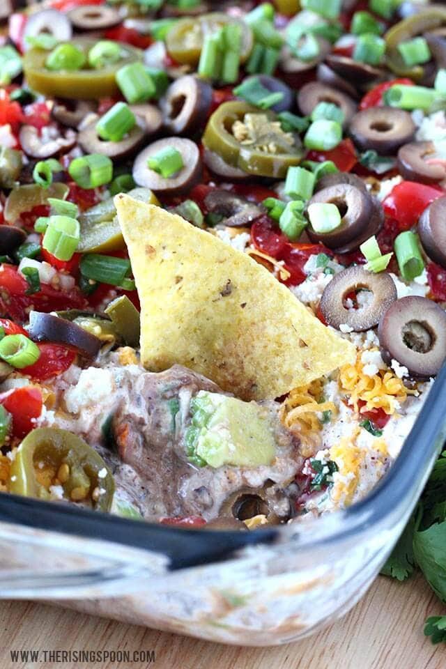 Layered Black Bean dip in rectangle dish