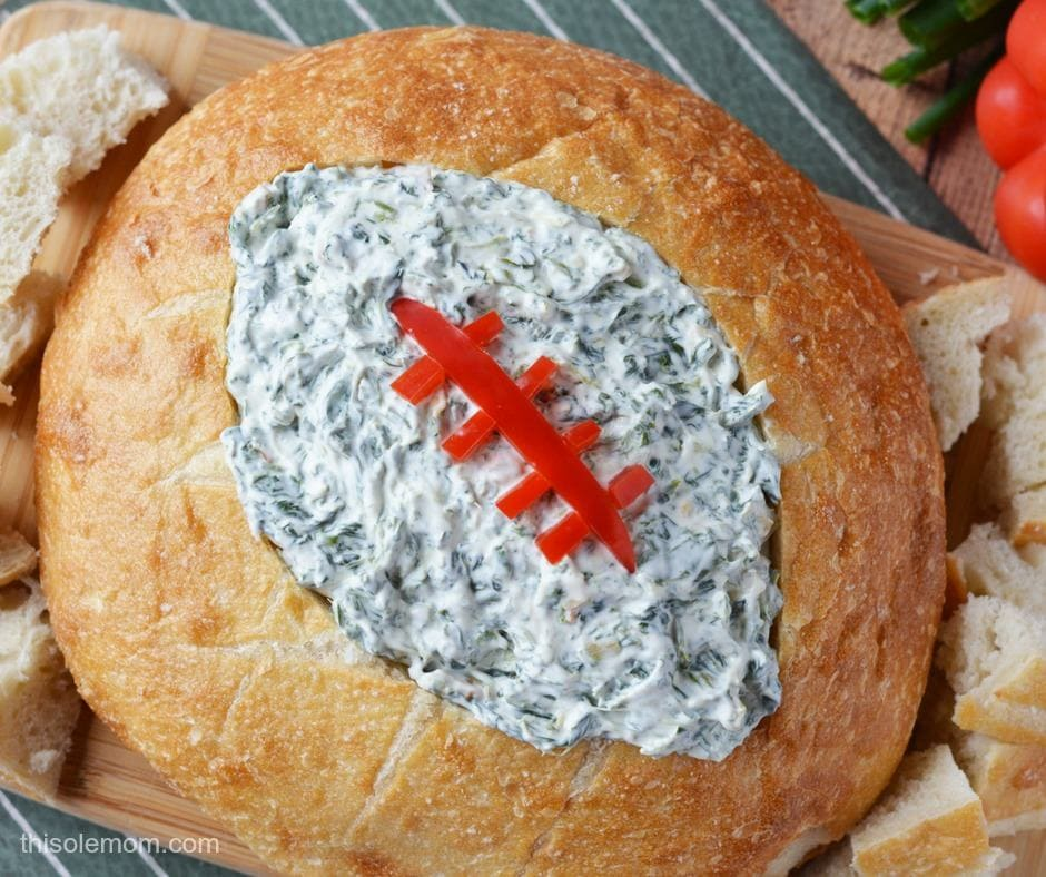 Spinach Dip in bread bowl with football cut out