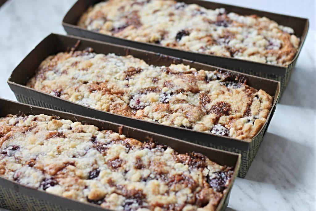 Three pans with cherry coffee cake lined up