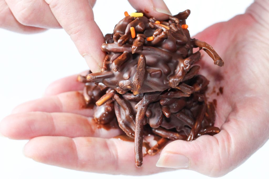 No bake chocolate haystack cookies stacked in hand