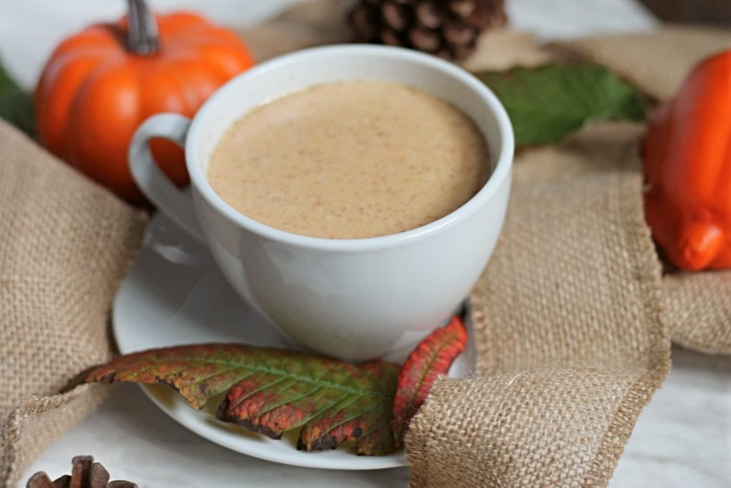 White tea cup with Pumpkin Hot Chocolate on burlap