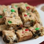 White dessert plate piled high with Christmas Cookie Bars
