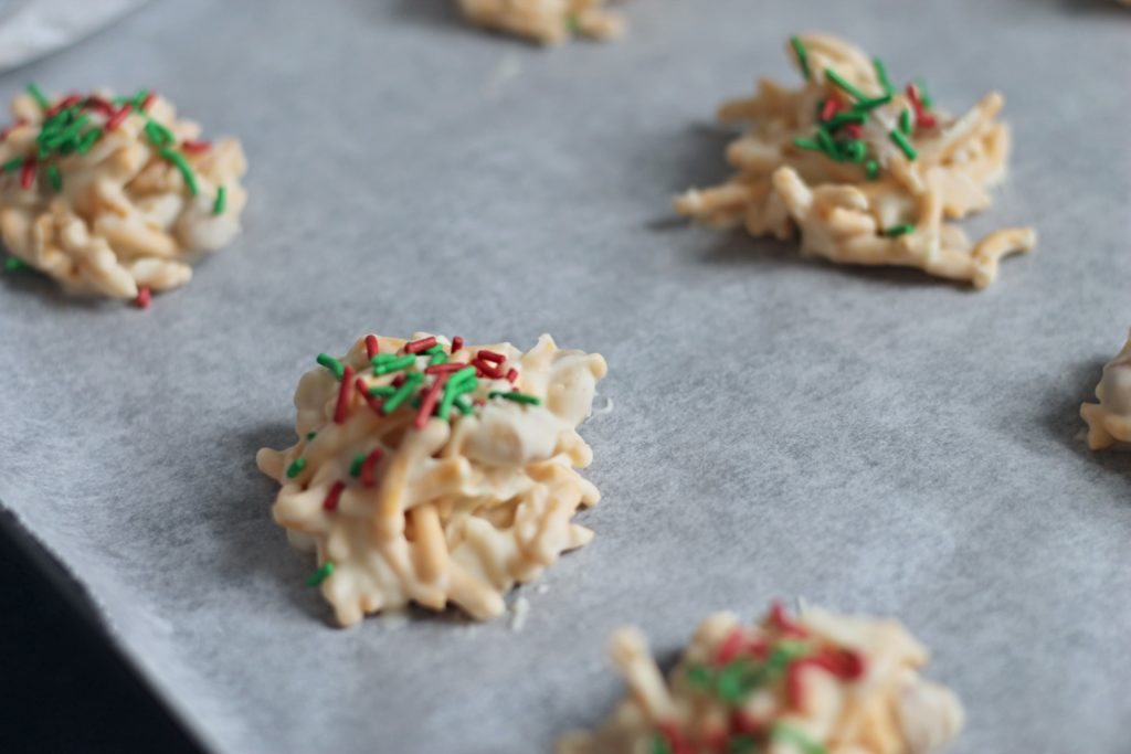 Close Up picture of our White Chocolate Haystack Recipe - Cookies on a Baking Sheet