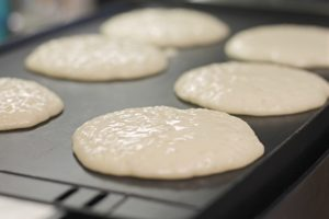 6 Fluffy Pancakes cooking on Griddle