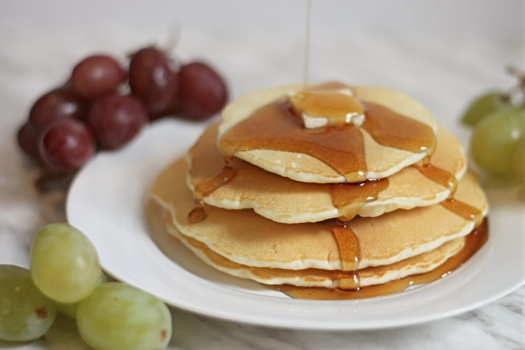 Stacked fluffy pancakes with Maple Syrup drizzle