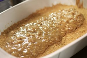 Poured toffee over graham crust for toffee bar recipe