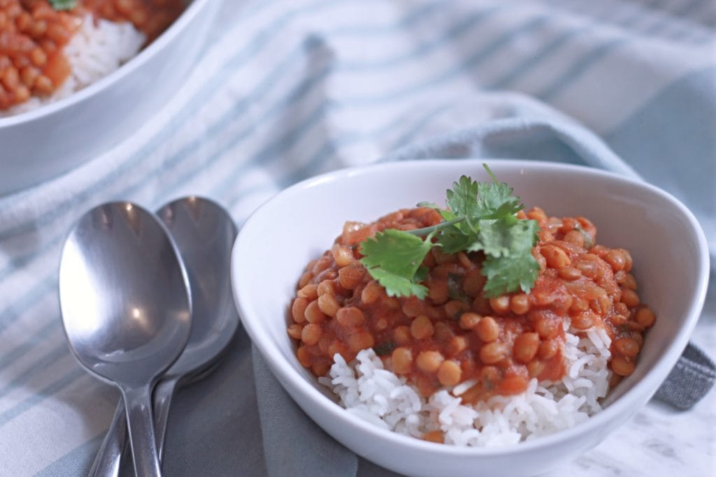 Bowls of Curried Lentils with spoons on a table