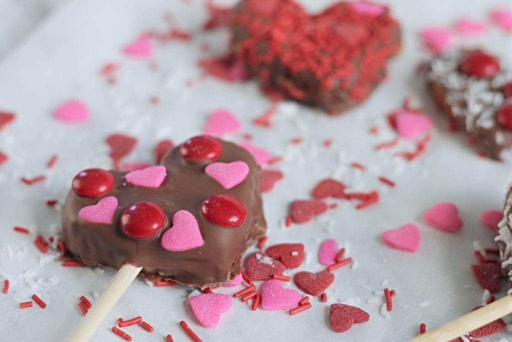 Chocolate Dipped Apple Hearts with heart sprinkles and candy coated chocolate
