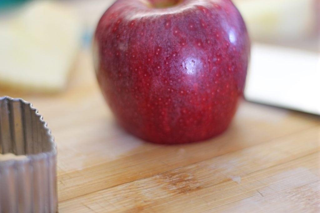 Apple on cutting board with bottom cut flat.
