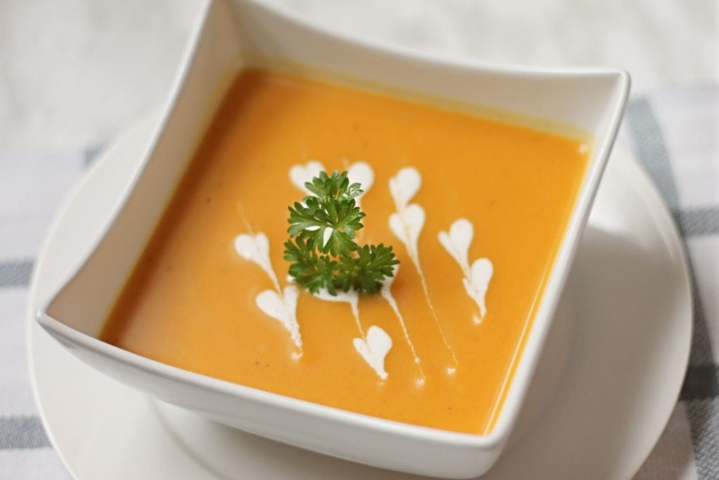 Butternut Squash Soup in white square bowl with garnish