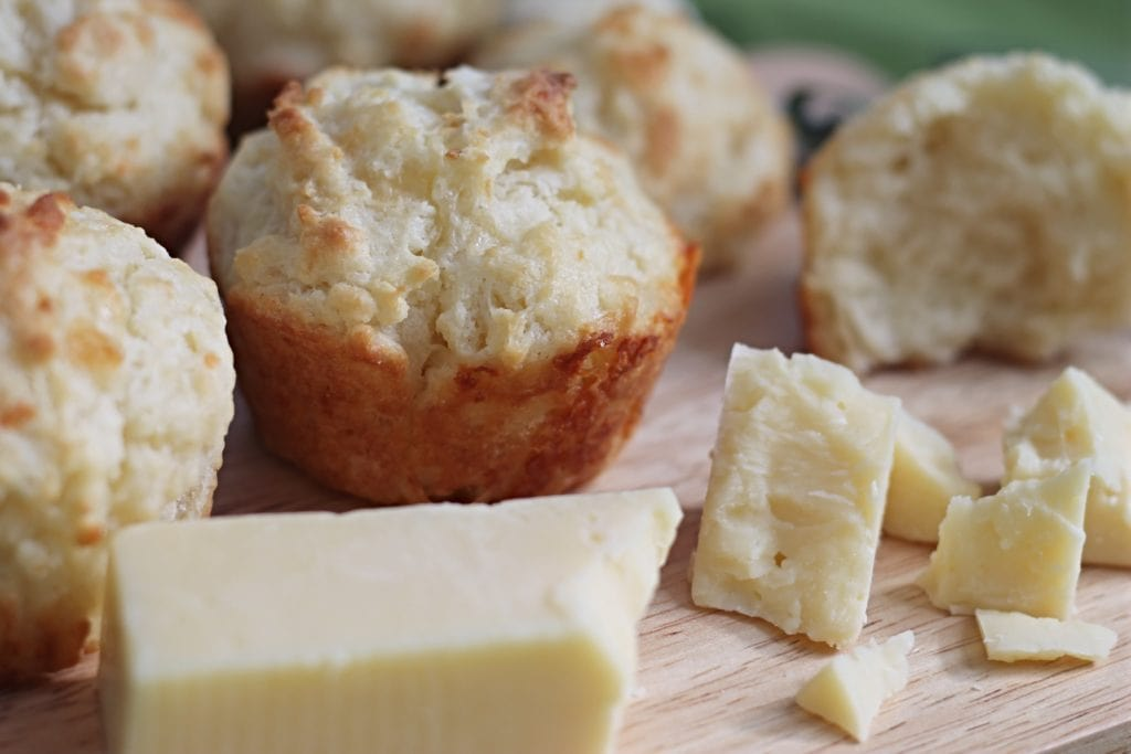 Soda Bread Muffins on cutting board with Irish Cheddar chunks