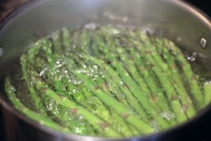 Asparagus spears in boiling water