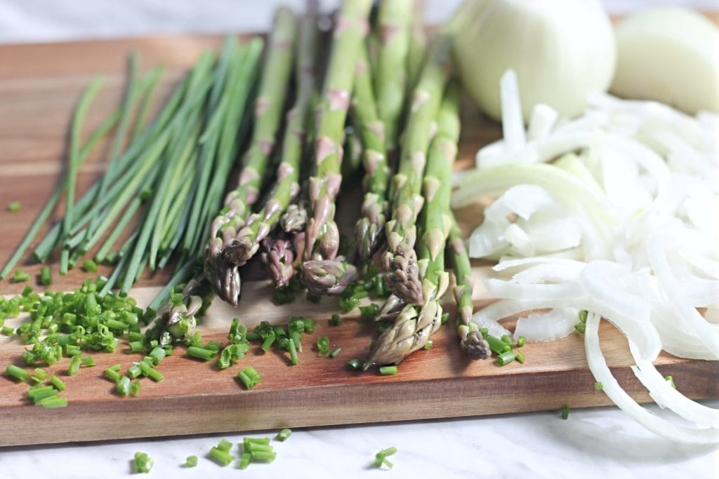 Fresh asparagus and chives with onions for tart