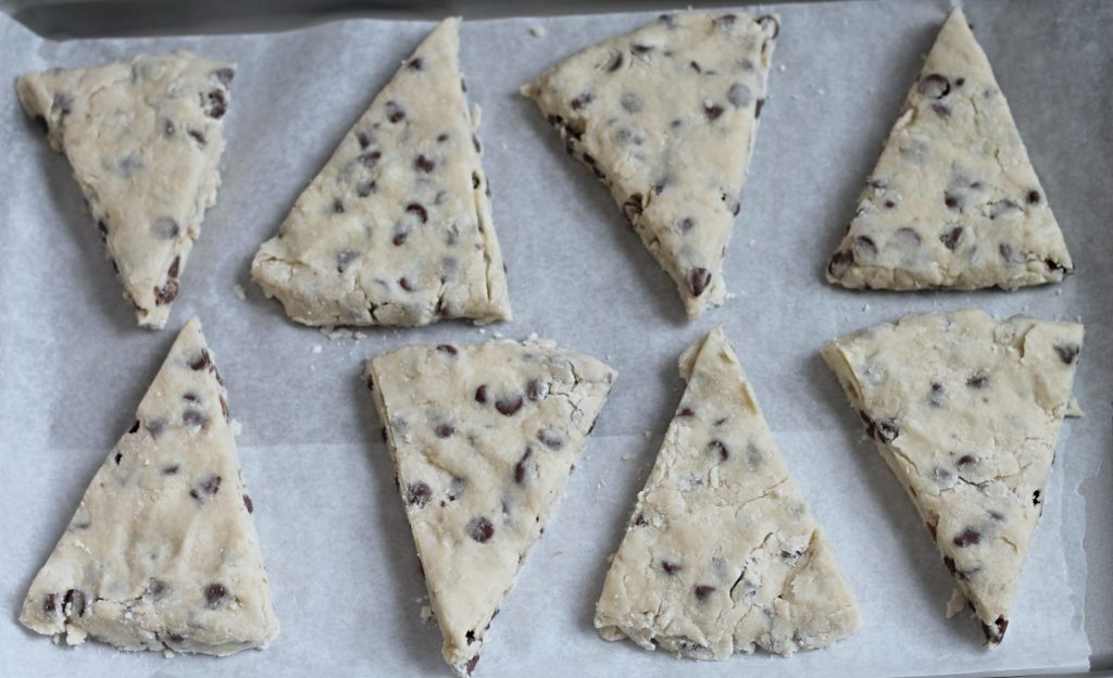 uncooked chocolate chip scones on baking sheet
