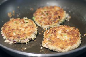 golden cooked tuna cakes in frying pan