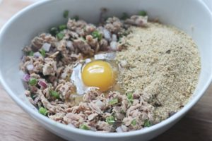 Tuna and mix ins for fish cakes in white bowl