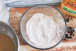 Dry ingredients for fruit muffin batter in large glass bowl
