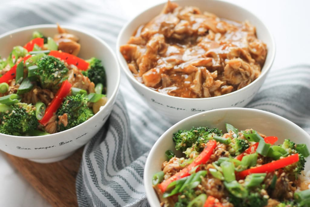 Sesame Chicken Stir-fry in two white bowls with vegetables