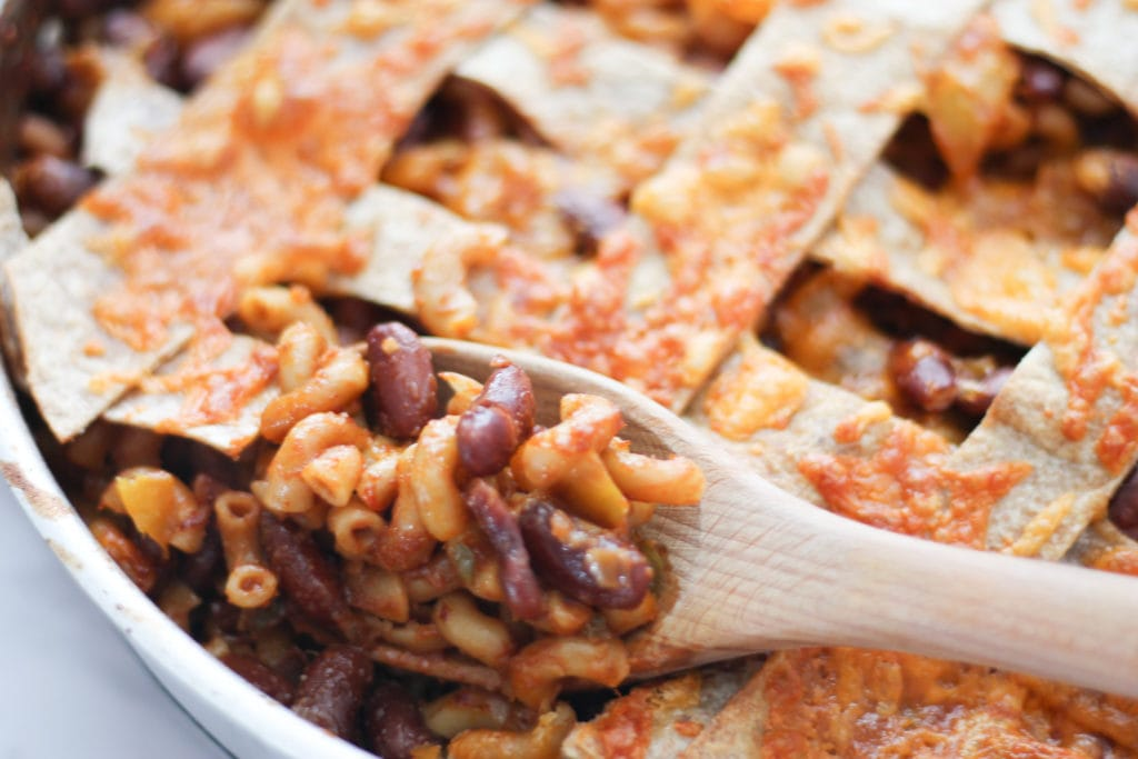 Skillet of Chili Mac with wooden spoon