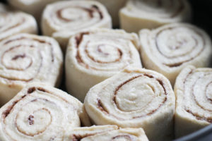 Cinnamon rolls rising in spring form pan