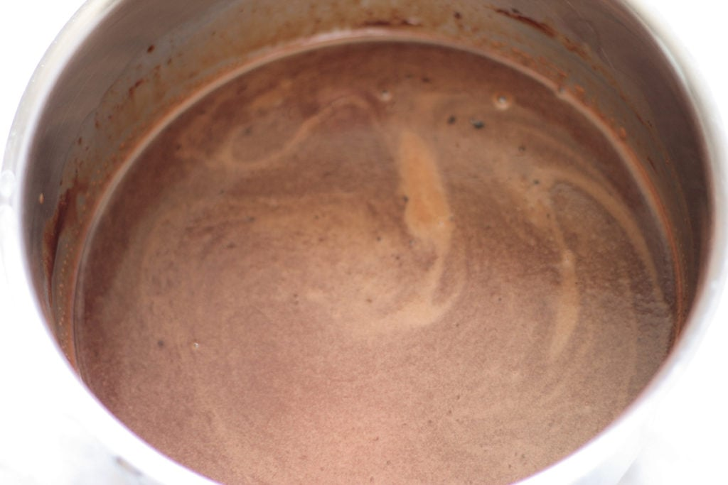 Stainless steel pot with melted chocolate syrup mixture