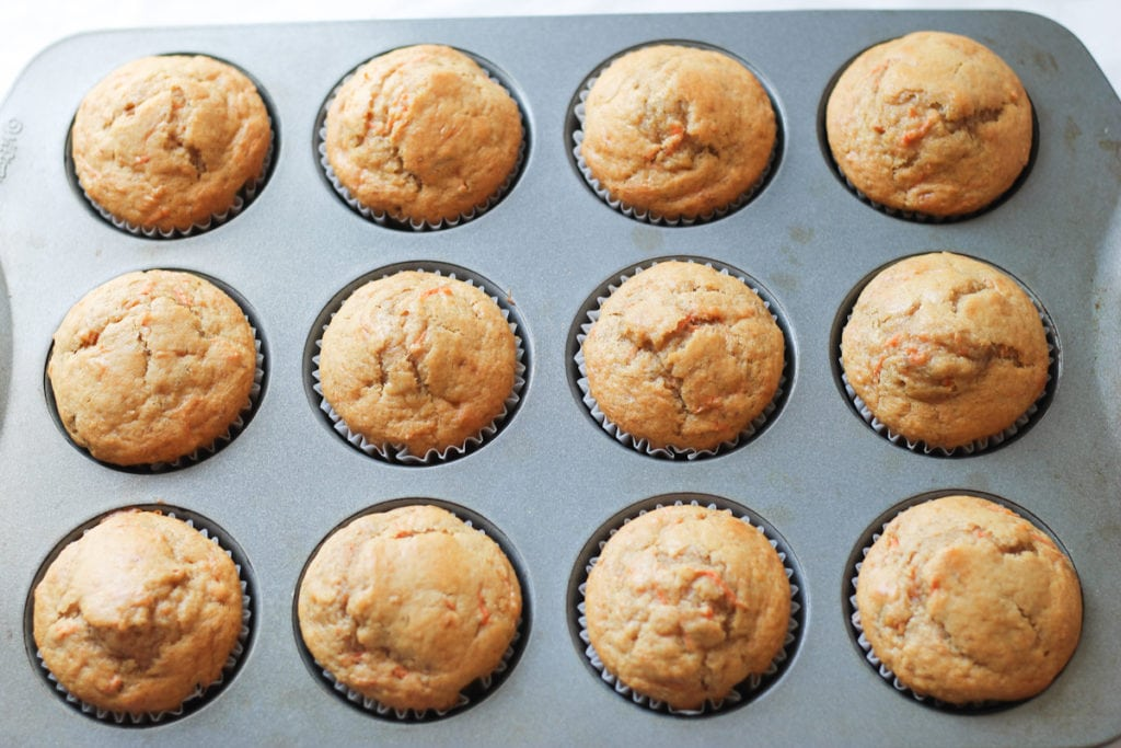 Muffin tin with fresh baked banana muffins