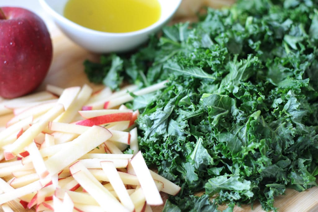 Cutting board with fresh chopped kale and apples