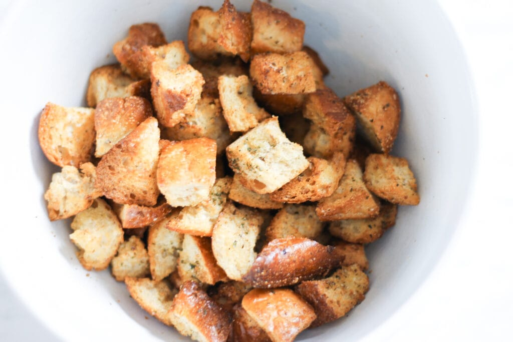 White bowl with croutons.