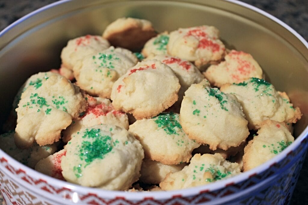 Christmas tin filled with whipped shortbread cookies.